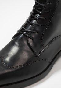 Giorgio 1958 - Šněrovací kotníkové boty - black - 5