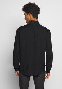 Just Cavalli - SHIRT SPARKLY SKULL - Košile - black - 2