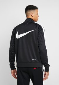 Nike Sportswear - Training jacket - black/white - 2