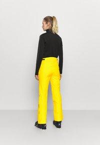 CMP - WOMAN  - Snow pants - yellow - 2