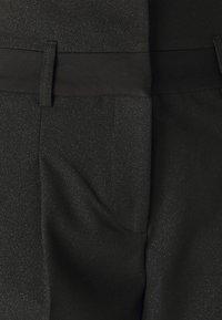 NAF NAF - ESHINY - Trousers - noir - 2