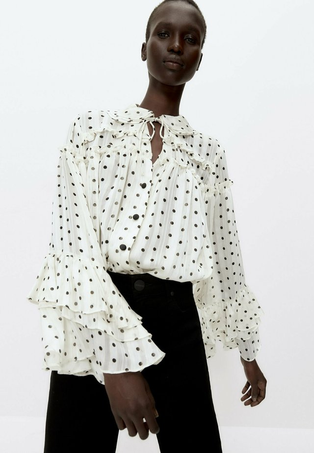 MIT LAMÉFÄDEN - Button-down blouse - beige