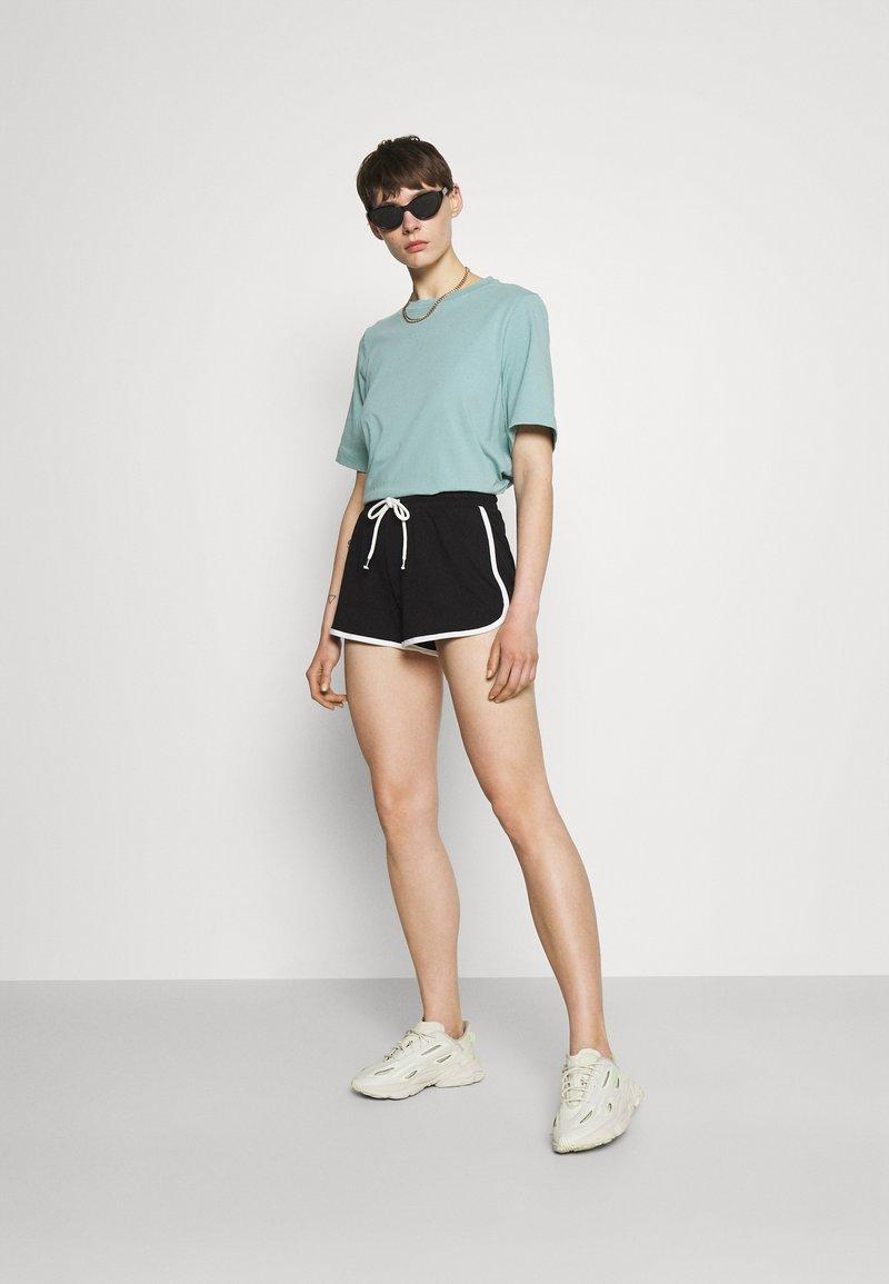 Monki - Pantaloni sportivi - blue/black