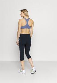 Champion - CAPRI PANTS - 3/4 sports trousers - dark blue - 2