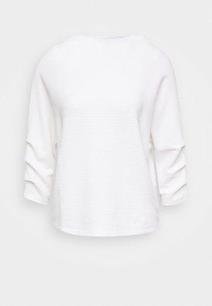 ULIRI OTTOMAN - Sweatshirt - milk