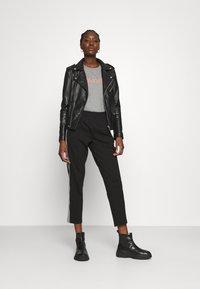 Calvin Klein - MILANO PANTS - Teplákové kalhoty - black - 1