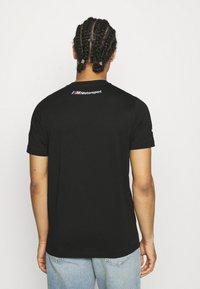 Puma - BMW VINTAGE TEE - Print T-shirt - black - 2
