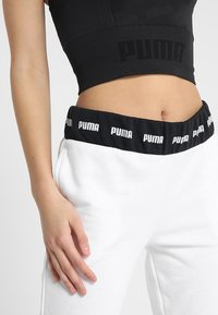 Puma - EVOKNIT SEAMLESS CROP - Funktionsshirt - black - 4