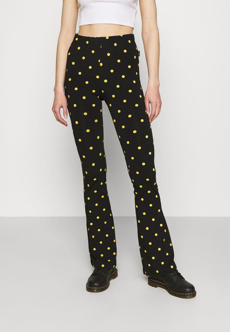 Colourful Rebel - DOTS BASIC FLARE PANTS WOMEN - Leggings - black