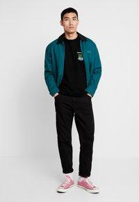 HUF - WOODSTOCK NOBODY CAME TEE - Print T-shirt - black - 1