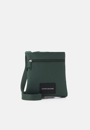 MICRO FLATPACK UNISEX - Sac bandoulière - green