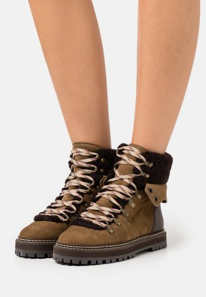 Lace-up ankle boots - terra/natural