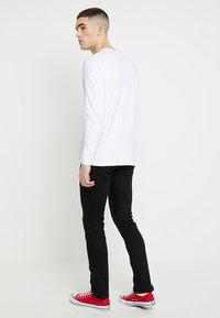 Nudie Jeans - GRIM TIM - Slim fit jeans - dry ever black - 2