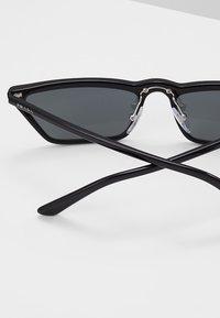 Prada - Lunettes de soleil - black - 4