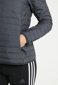 adidas Performance - VARILITY SOFT HOODED OUTDOOR DOWN JACKET - Winter jacket - carbon - 4