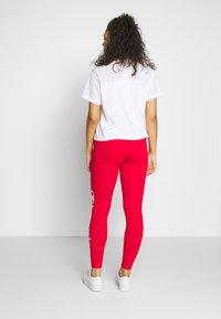 Champion - LEGGINGS - Collant - red - 2