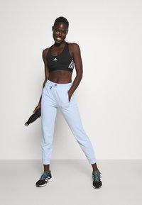 Calvin Klein Performance - PANTS - Tracksuit bottoms - sweet blue - 1