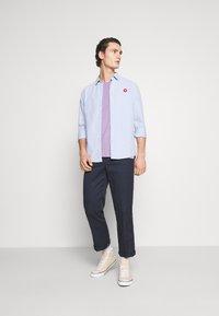 YOURTURN - UNISEX - Print T-shirt - lilac - 1