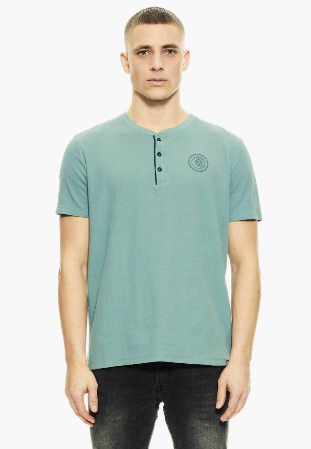 T-shirt con stampa - ocean green
