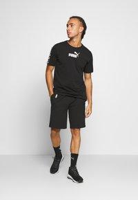 Puma - AMPLIFIED TEE - T-shirt med print - black - 1