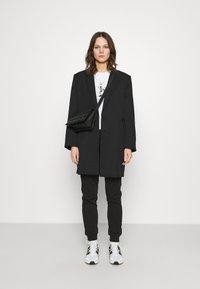 Calvin Klein Jeans - LOGO PANTS - Tracksuit bottoms - black - 1