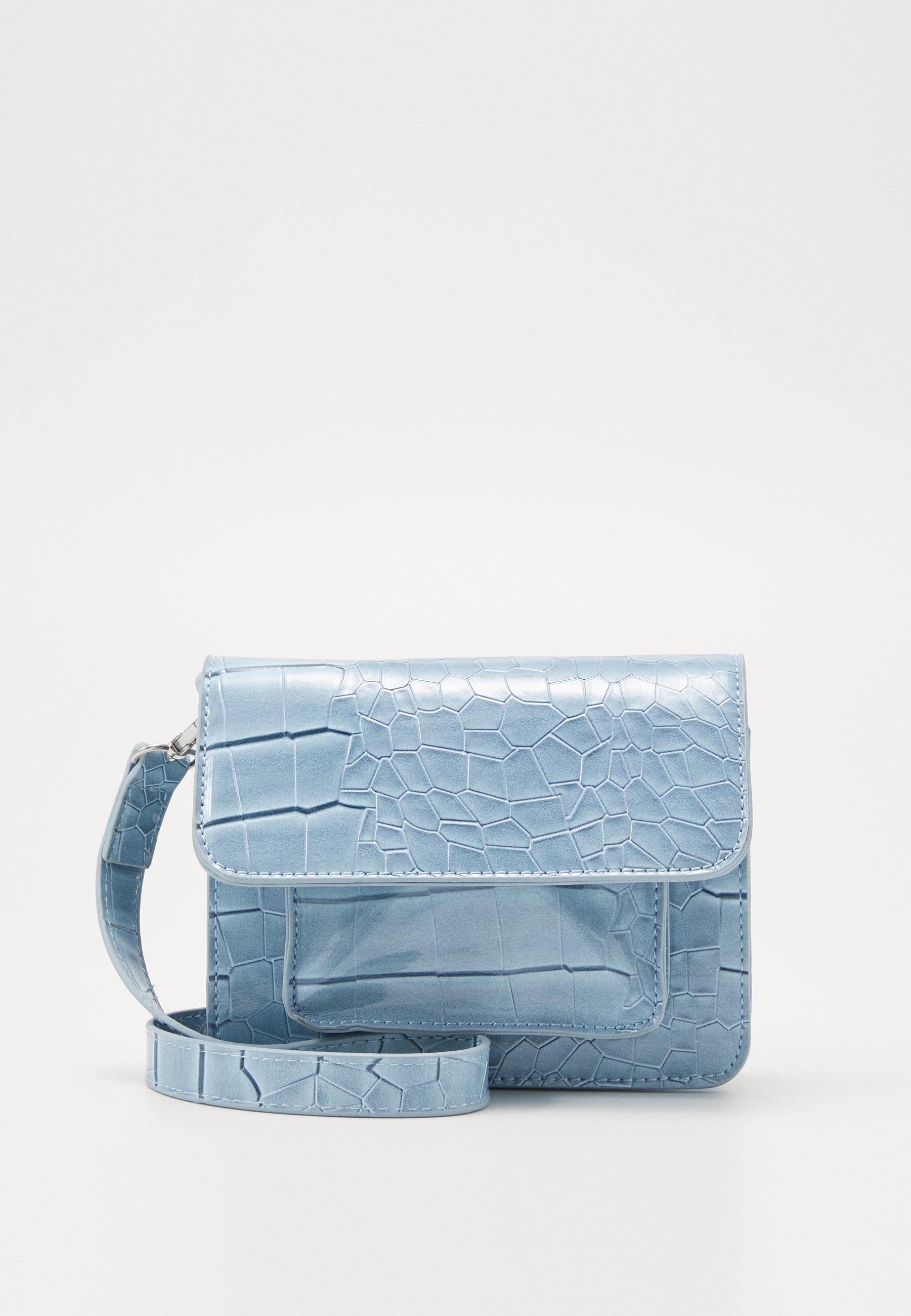 CAYMAN MINI Axelremsväska dusty blue
