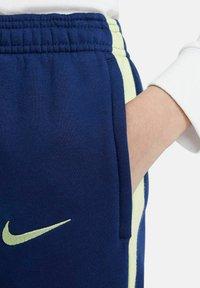 Nike Performance - Tracksuit bottoms - nachtblau - 1
