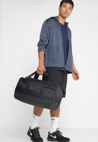 Nike Performance - POWER DUFF - Sports bag - black/black/black - 1