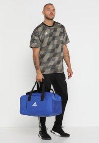 adidas Performance - Sports bag - bold blue/white - 1