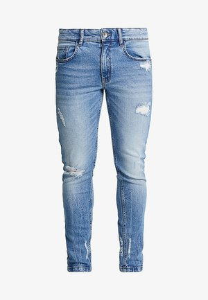 STOCKHOLM DESTROY - Jeansy Slim Fit - soft blue