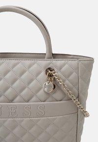 Guess - ILLY ELITE TOTE - Handbag - grey - 4