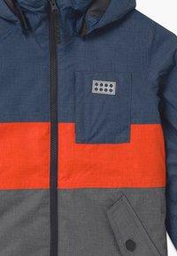 LEGO Wear - JOSHUA UNISEX - Winter jacket - light blue - 3