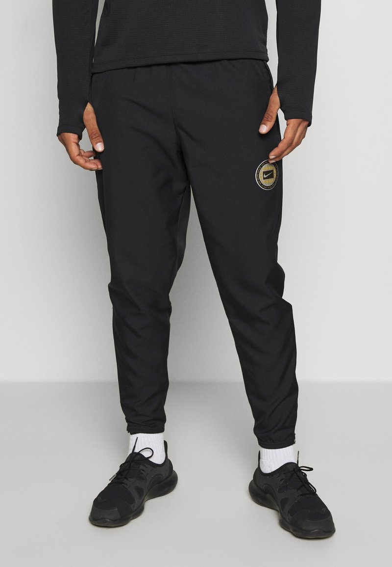 Nike Performance - ESSENTIAL PANT - Tracksuit bottoms - black/particle grey