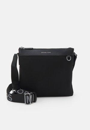 FLAT CROSSBODY UNISEX - Across body bag - black