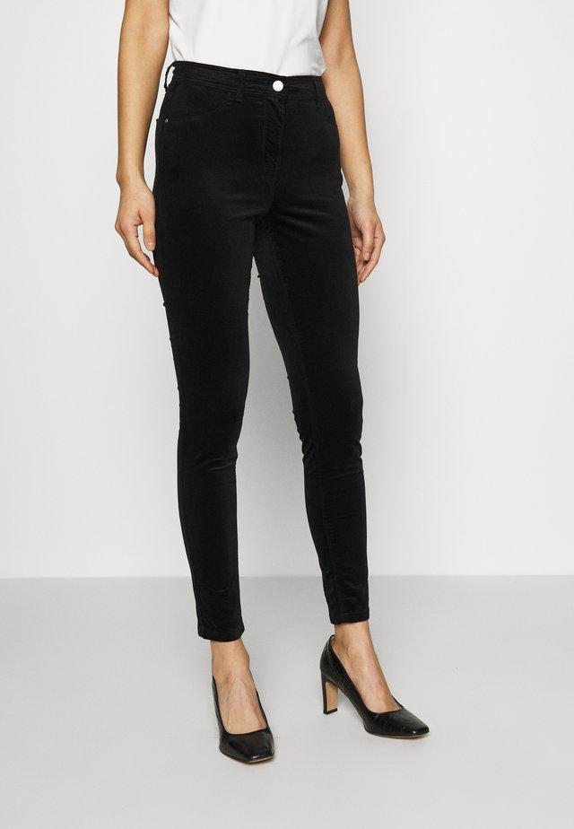 FRANKIE - Trousers - black