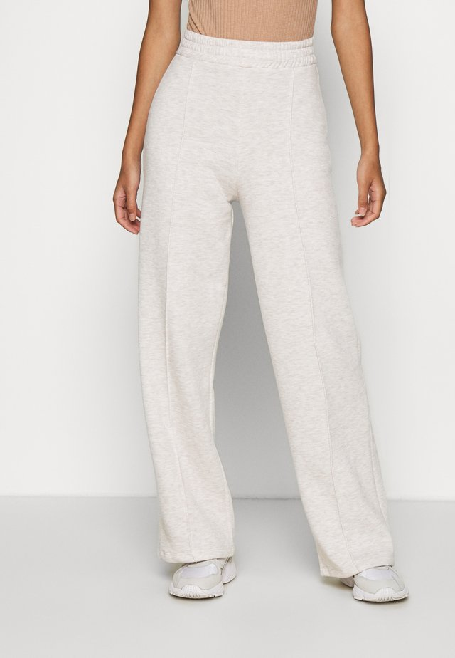 STRAIGHT COZY PANTS - Tracksuit bottoms - beige mélange