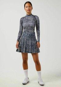 J.LINDEBERG - Sports skirt - jl navy croco - 1