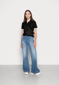 Lacoste - Poloshirt - black - 1