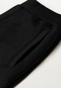 Mango - MARCIANO - Trousers - black - 6