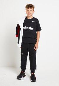 Nike Sportswear - AIR - Trainingsbroek - black/white - 1