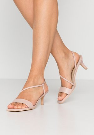 CROSS STRAPPED HEEL  - Sandalias - pink