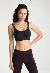 triaction by Triumph - EXTREME LITE - Light support sports bra - black - 0
