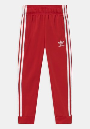 UNISEX - Tracksuit bottoms - scarlet/white