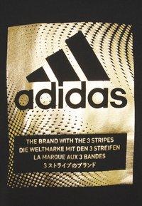 adidas Performance - Print T-shirt - black/gold metallic - 2