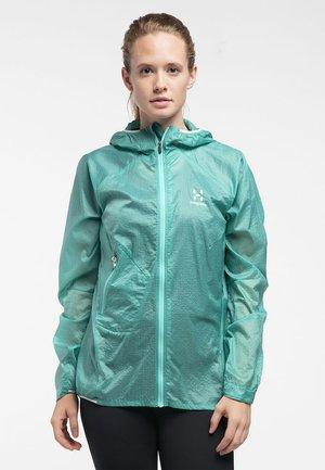 HAGLÖFS WINDBREAKER L.I.M SHIELD COMP HOOD WOMEN - Hardshell jacket - glacier green
