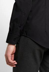 Seidensticker - SLIM FIT - Formal shirt - black - 3