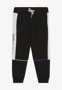 Puma - SEGA PANTS - Pantalon de survêtement - black - 2