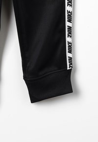 Nike Sportswear - NIKE BLOCK TAPING TRICOT SET - Tracksuit - black - 5