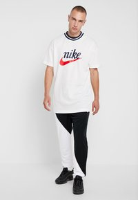 Nike Sportswear - PANT - Træningsbukser - black/white - 1