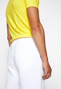 Polo Ralph Lauren - MAGIC  - Pantaloni sportivi - white
